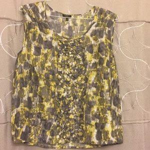 Sleeveless blouse 100% silk.